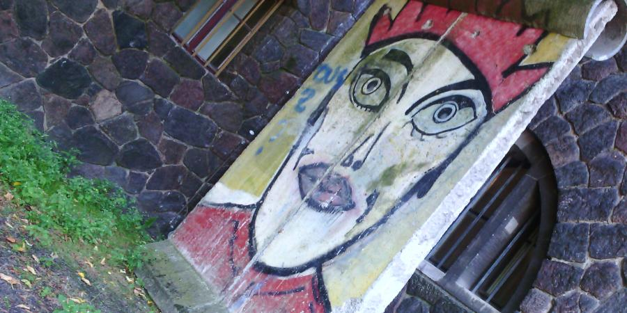 Photo of Berlin Wall piece with graffito by Kiddy Citny