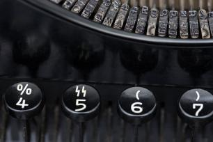 "Typewriter displaying key with ""SS""-runes"