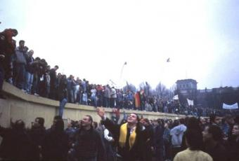 People celebrating on the Wall near the Reichstag building, 12 November 1989
