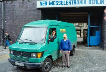 "Photo of delivery van of Turkish wholesaler ""Fruta"" in front of GDR factory, East Berlin, 1990"