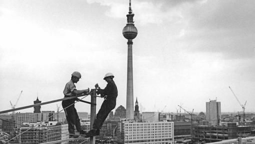 Construction workers atop the Haus der Statistik, 1969